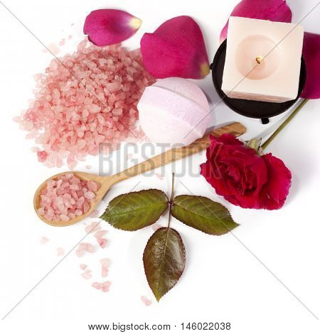 pink rose, sea salt, and candle for Spa and aromatherapy on a white background