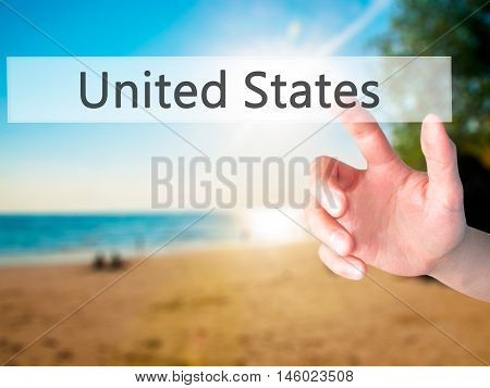 United States - Hand Pressing A Button On Blurred Background Concept On Visual Screen.