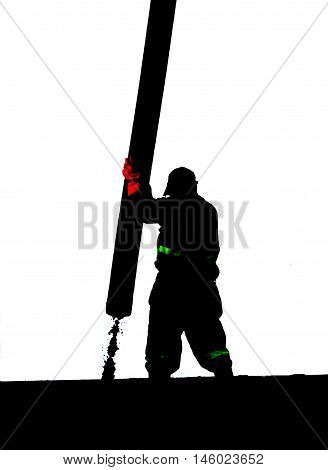 Silhouette of construction worker handling cement from concrete pump