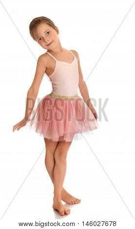 Beautiful barefoot girl gymnast in pink dress . the girl crossed her legs-Isolated on white background