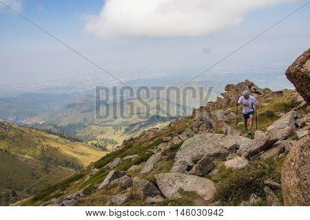 ALMATY KAZAKHSTAN - 20 AUGUST: Skyrunner runs in the mountains - Gorge Kim-Asar Tien-Shan mountains peak named Furmanova