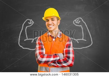 Self-confident construction worker in front of chalkboard with muscles drawn with chalk