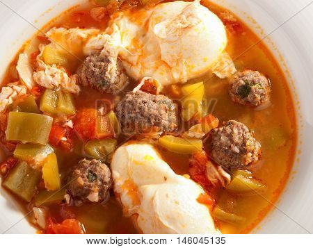 Tunisian soup with meatballs and eggs. Shot from above horizontal view