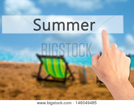 Summer - Hand Pressing A Button On Blurred Background Concept On Visual Screen.