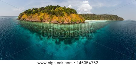 View of the island surrounded by coral reefs. Andaman sea, Thailand
