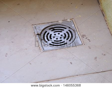 stainless steel drain on the floor in bath room