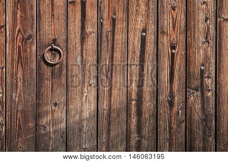 Old Dark Wooden Gate With Ring Handle
