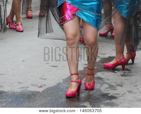 Cajamarca Peru - February 7 2016: Costumed woman's legs in bright pink shoes in Carnival parade in Cajamarca Peru on February 7 2016