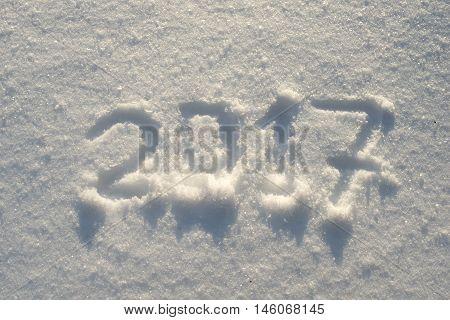 2017 numbers written on fresh snow field