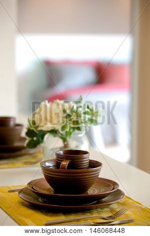 A set of plate bow and cup on a dinning table