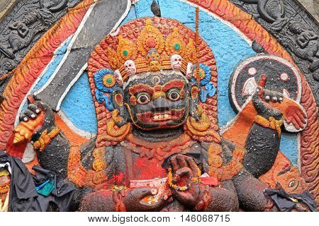 KATHMANDU, NEPAL - APRIL 2014 : Closeup of Kal Bhairav statue at Kathmandu Durbar Square in Kathmandu, Nepal on 12 April 2014. A huge stone image of Bhairav represents deity Shiva in his worship