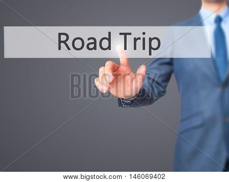 Road Trip - Businessman Hand Pressing Button On Touch Screen Interface.