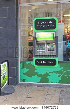 LONDON UNITED KINGDOM - JANUARY 22: Free Cash Withdrawals Bank Machine in London on JANUARY 22 2013. Automated Teller Cash Machine in Shop Window in London United Kingdom.