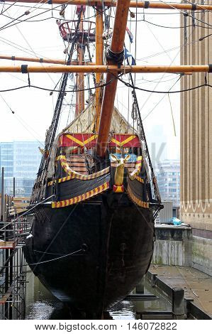 LONDON UNITED KINGDOM - JANUARY 19: Golden Hinde Ship Restoration in London on JANUARY 19 2013. Famous Captain Sir Francis Drake Galleon Replica During Reconstruction at Southwark in London United Kingdom.
