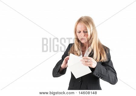 Middle Aged Woman Opens A Letter