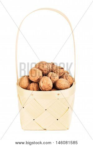 walnut in wooden basket, isolated on white background