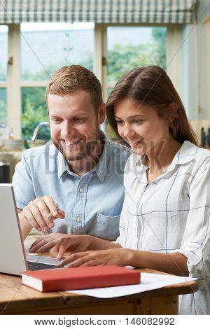 Male Home Tutor Helping Teenage Girl With Studies
