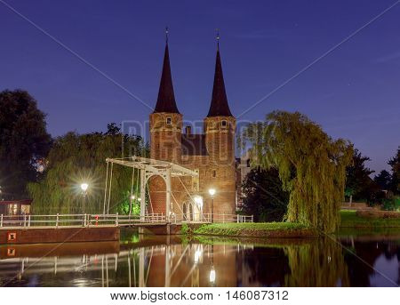 Eastern Gate with the white draw bridge, along Delftse Schie canal at night, Delft, Holland, Netherlands