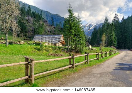 Spring sunny mountain landscape. Wooden hut in a beautiful mountain valley in Western Tatra Poland.