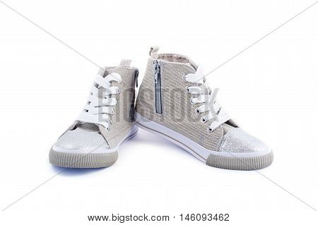 Beige jeans sneakers with white laces isolated on white