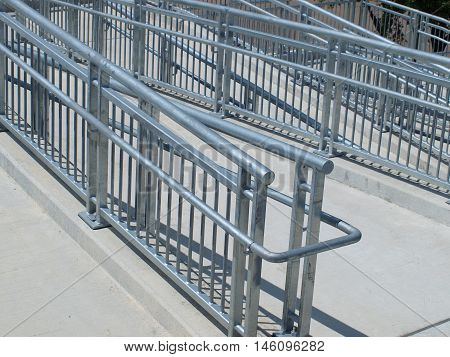 Switchback ramp to sky bridge crossing major traffic artery.