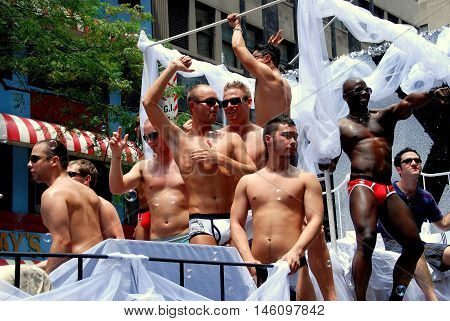 New York City - June 30 2007: Nearly naked muscle men riding on a float at the 2007 Gay Pride Parade on Fifth Avenue