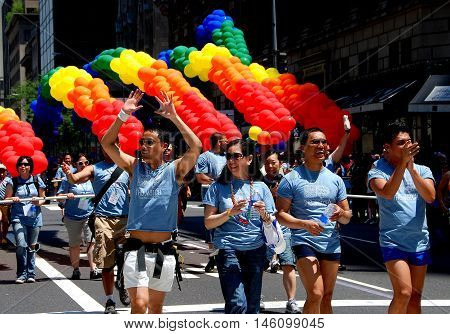 New York City - June 30 2007: Staff marchers with the rainbow flag balloon arches at the 2007 Gay Prtide Parade on Fifth Avenue