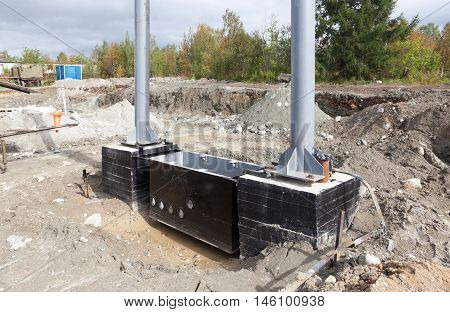 Metal and concrete structures are assembled for installation on construction site