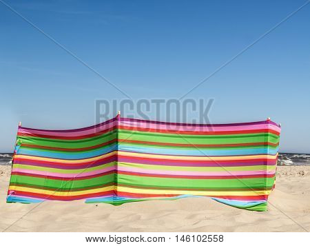 Colorful striped windbreak at the beach