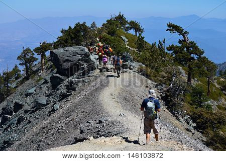 September 4, 2016 in Mt Baldy, CA:  People hiking the Devils Backbone Trail with amazing views of Southern California and this is a trail that people can take to the summit of Mt Baldy, CA which has an elevation of over 10,000 feet