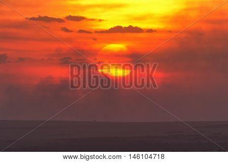 Typical african sunset in Masai Mara Kenya Africa. Horizontal shot
