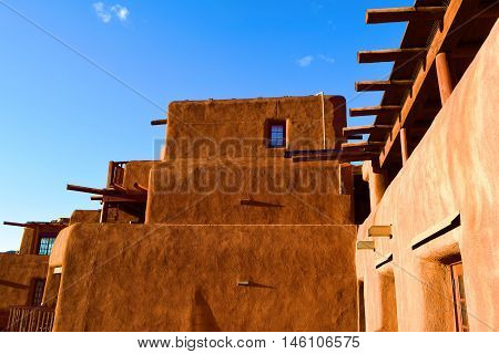 Historic adobe style pueblo with southwestern architectural design taken in Santa Fe, NM