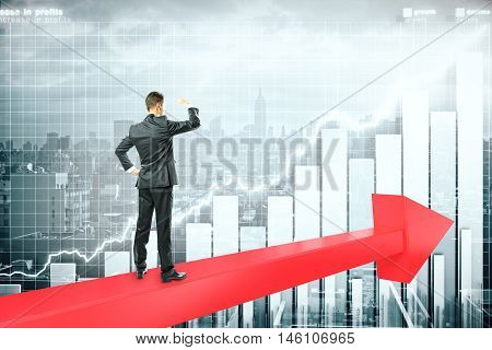 Success concept with businessman standing on red chart arrow and looking intor the distance on city with business graph background. 3D Rendering