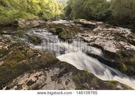 An image of the River Dart flowing through Dartmoor National Park, Devon, England, UK