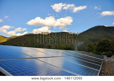 Northern Thailand, December 23, 2010: Solar PV with mountain in the background, Northern Thailand.
