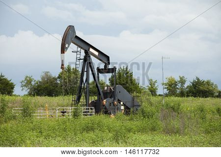 Oil pump in an open refinery field.
