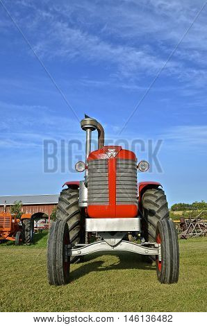 ROLLAG, MINNESOTA, Sept 1, 2016: A restored Massey Harris tractor is restored and displayed at the West Central Steam Threshers Reunion(WCSTR) where 1000s attend each Labor Day weekend in Rollag, MN each year.