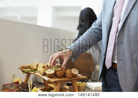 Close Up Of Businessman At Conference Lunch Buffet