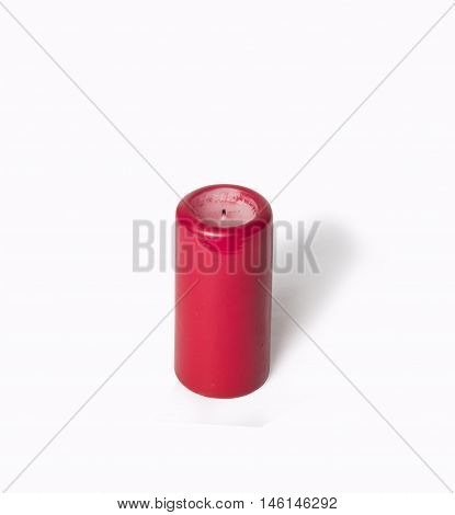 Paraffin candles red isolate on a white background close-up photography