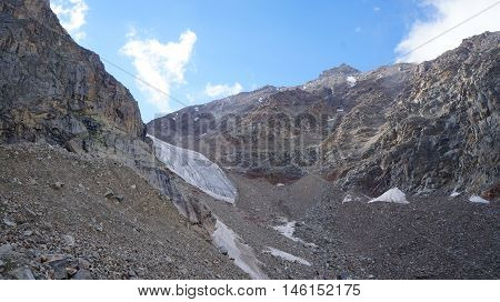 Alpinists at glacier, Bezengi area, Caucasus, Russia.