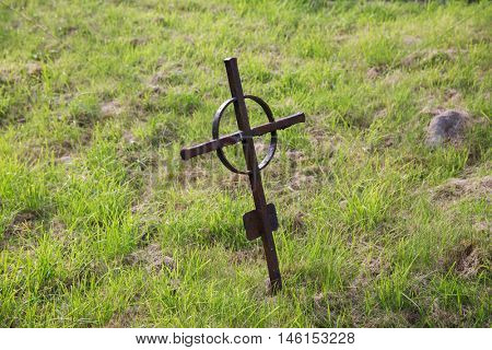 graveyard and burial concept - old rusty grave cross on celtic cemetery graveyard in ireland
