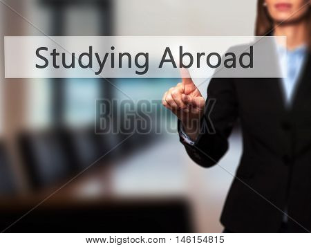 Studying Abroad - Businesswoman Hand Pressing Button On Touch Screen Interface.