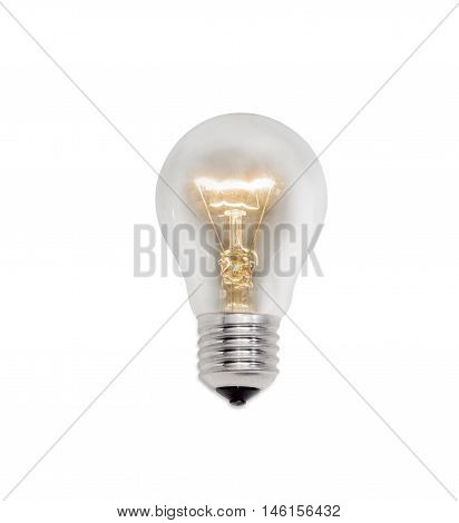 Glowing incandescent light bulb with a medium sized E27 male screw base on a light background