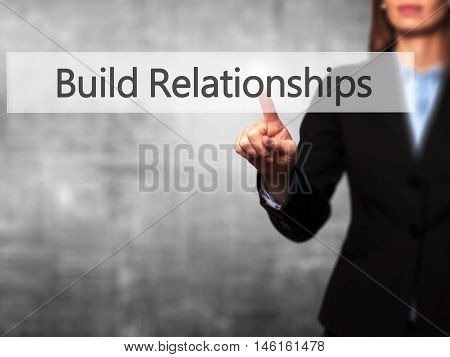 Build Relationships - Businesswoman Hand Pressing Button On Touch Screen Interface.