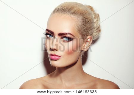 Vintage style portrait of young beautiful blonde girl with stylish fresh make-up