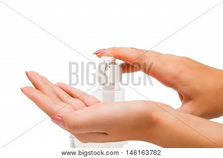 Women's hands with soap on a white background
