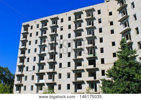Facade of abandoned multistory building in Ukraine