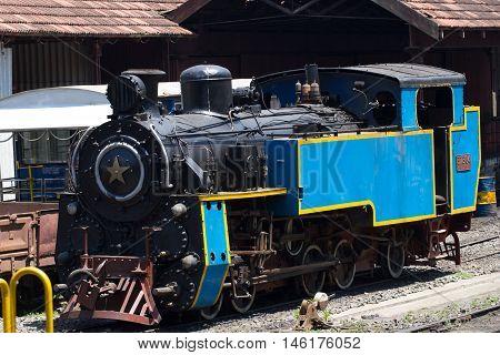 Nilgiri mountain railway. Blue train. Unesco world heritage. Narrow-gauge. Steam locomotive in depot