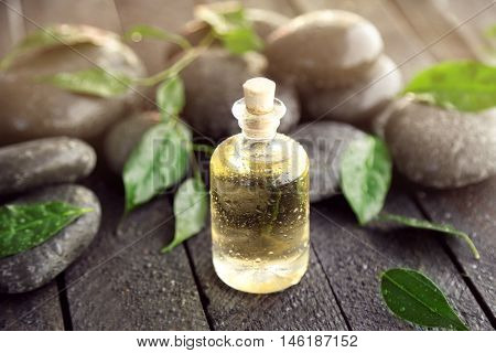 Beautiful composition with tea oil and spa stones