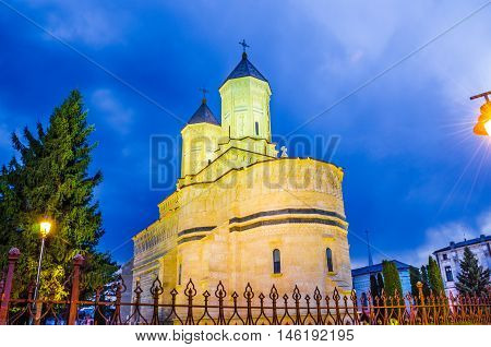 Beautiful and religious monastery of Cetatuia village, Iasi, illuminated at night, over the blue sky